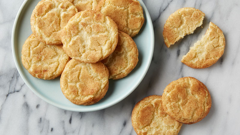 What makes snickerdoodles so, well, snickerdoodley? Its distinctive crackling and cinnamon-sugar topping make it a standout cookie treat. Don't forget to include cream of tartar on your grocery shopping list when you're planning to bake snickerdoodle cookies. Along with baking soda, it's the secret to the cookie's leavening. Some home cooks claim that hand mixing the snickerdoodles, instead of using an electric beater creates a better cookie, but you be the judge! Ingredients 1 1/2 cups sugar 1/2 cup butter, softened 1/2 cup shortening 2 eggs SAVE $ 2 3/4 cups Gold Medal™ all-purpose or unbleached flour 2 teaspoons cream of tartar 1 teaspoon baking soda 1/4 teaspoon salt 1/4 cup sugar 2 teaspoons ground cinnamon Heat oven to 400°F. Mix 1 1/2 cups sugar, the butter, shortening and eggs in large bowl. Stir in flour, cream of tartar, baking soda and salt. Shape dough into 1 1/4-inch balls. Mix 1/4 cup sugar and the cinnamon. Roll balls in cinnamon-sugar mixture. Place 2 inches apart on ungreased cookie sheet. Bake 8 to 10 minutes or until set. Remove from cookie sheet to wire rack. Be sure to measure the flour carefully, spooning it into a measuring cup and leveling it off with a metal spatula or back of a straight knife. Too much flour will make what should be a light, chewy cookie denser and more cake-like. What is cream of tartar? It's actually a stabilizer (potassium bitartrate) and is often used when whipping air into egg whites and cream. Because it's an acid, it can be added to sugar syrups to reduce crystallization—and in cookies, in combination with baking soda, it actually forms a type of baking powder. Avoid overmixing as you incorporate the dry ingredients into the wet which can result in a tough cookie. You want your cookie dough balls well coated in the cinnamon-sugar mixture, since that's the best part! The best way to do it? Pour the mixture onto a large plate, so there's plenty of room for rolling. For best results, bake cookies on the middle oven rack. For even baking, it's best to bake your classic Snickerdoodle cookies one baking sheet at a time.